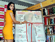 Nargis Fakhri unveiling the latest issue of WOMENS HEALTH magazine at the Crossword Store in Mumbai Photo