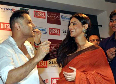 Vidya Balan feeding cake to Sujoy Ghosh at the DVD launch of their film KAHANI at Diesel Store Photo