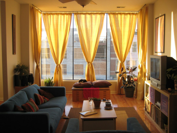 Amazing new modern curtain for small living room design for Yellow modern living room ideas