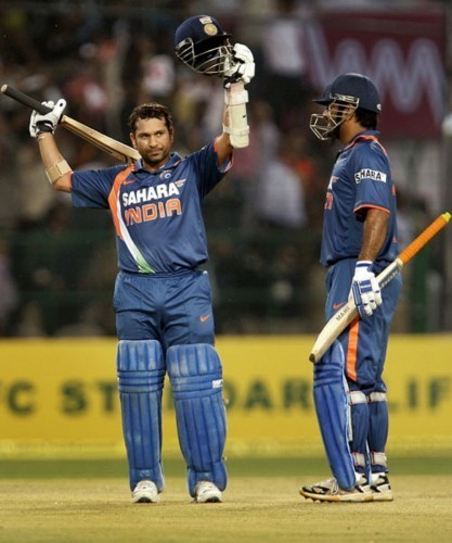 ms dhoni is happy as sachin tendulkar reaches 200 417x500